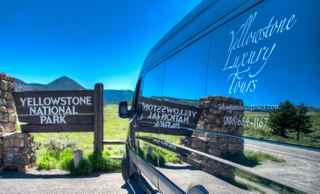 Yellowstone Luxury Tours' Mercedes Sprinter Van at the Gateway to Yellowstone National Park